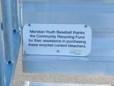 sign attached to bleachers indicating they were purchased with assistance from MCRF