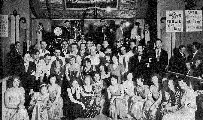 women and men in formal clothes at the Red, White and Blue Dance Hall