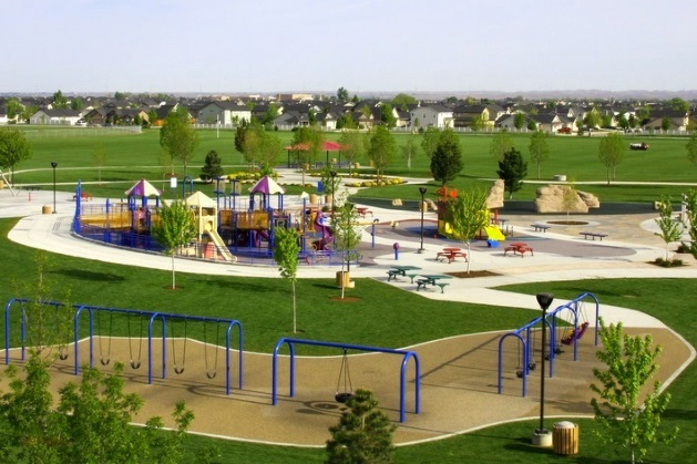 view of playground at Settler's Park with a neighborhood in the distance