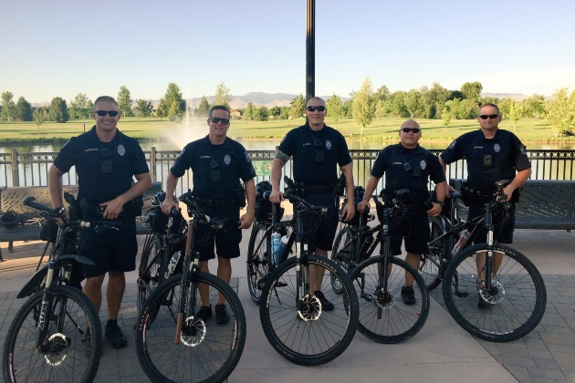 5 police officers standing with their patrol bikes