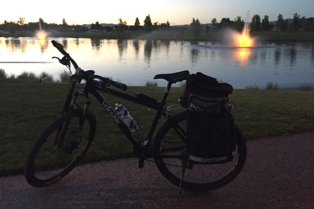 a patrol bike near a pong at sunset