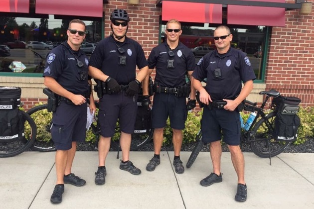 Bike Patrol Officers standing together and smiling