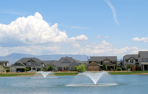 scenic neighborhood with pond and fountains